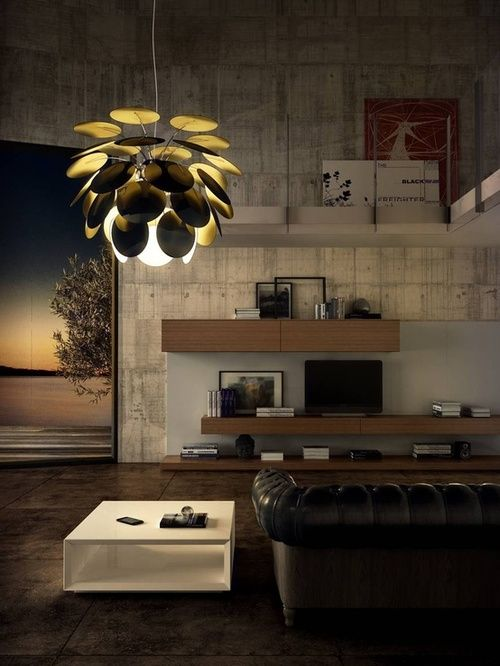 unique scaulptural scale pendant lamp is a focal point
