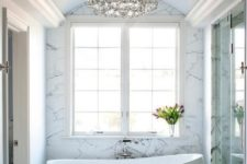 28 white and gray bathroom features an egg shaped tub and a vintage style hand held tub filler
