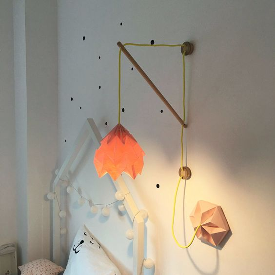 An Orange Geometic Wall Lamp For A S E