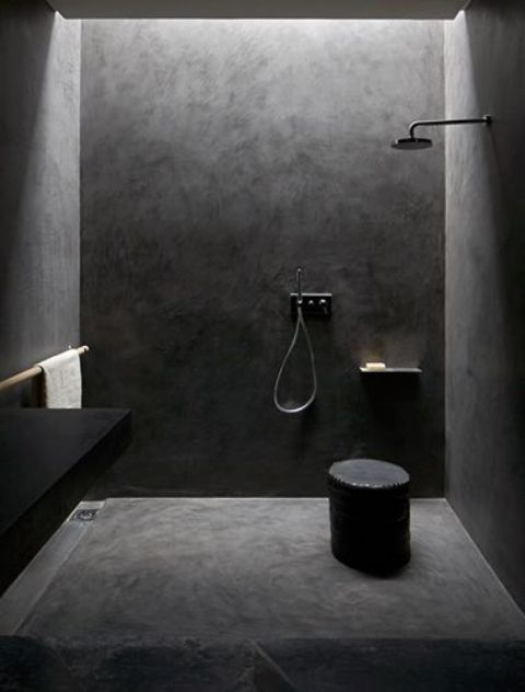 dark concrete all over the shower for a minimalist look