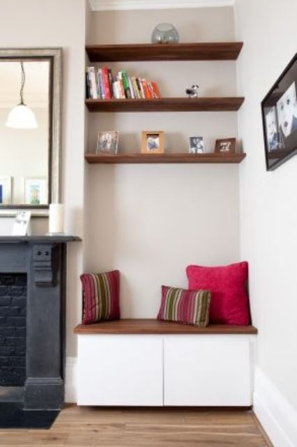 dark stained floating shelves echo with a cabinet top