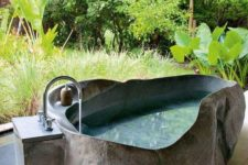 29 outdoor bathroom with an irregular shaped stone bathtub with a raw edge makes you feel like in an oasis