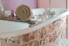 29 the beautiful shell mosaic on the tub screams beach and ocean