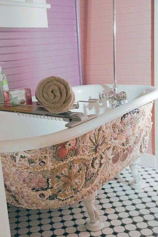 the beautiful shell mosaic on the tub screams beach and ocean