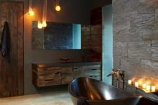 30 a masculine bathroom with a dark metal bathtub, which makes a statement