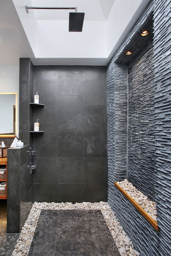 black stone and pebbles all around for a cool spa-like look