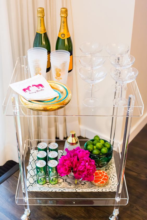 lucite rolling bar cart can easily fit any space