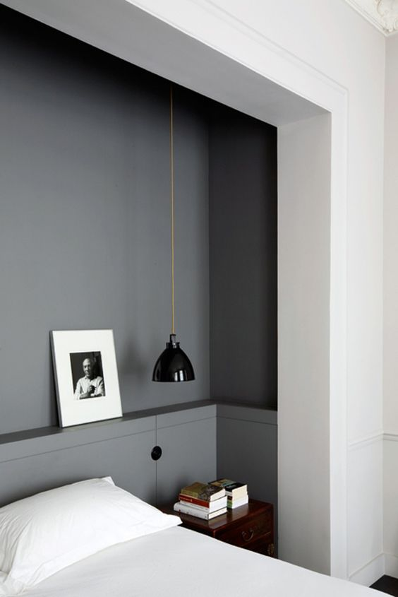 a mid-century modern black lamp looks great in a grey manly bedroom