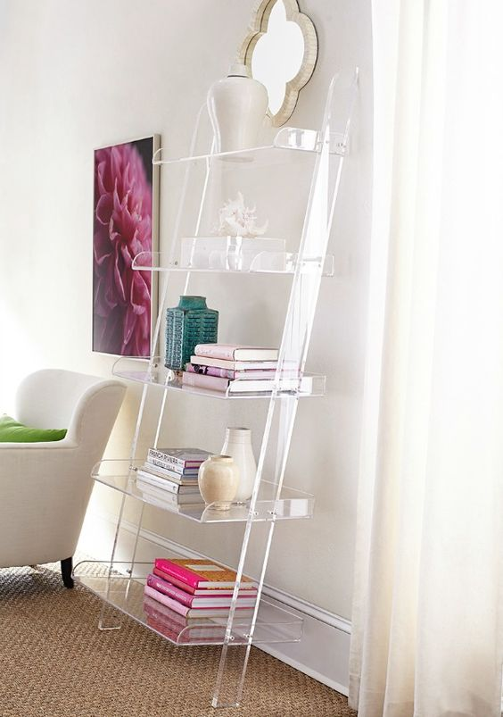 acrylic leaning bookshelf looks cool in this glam girlish space
