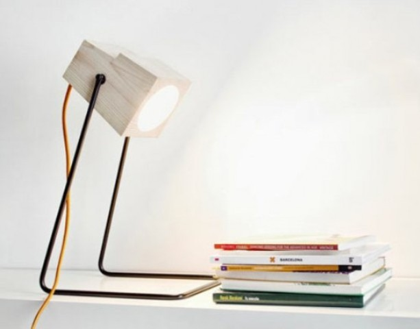 an industrial lamp made of metal legs and a white wood part