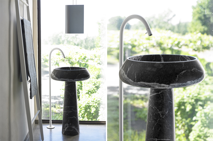 black marble free standing sink is an elegant solution for a manly space