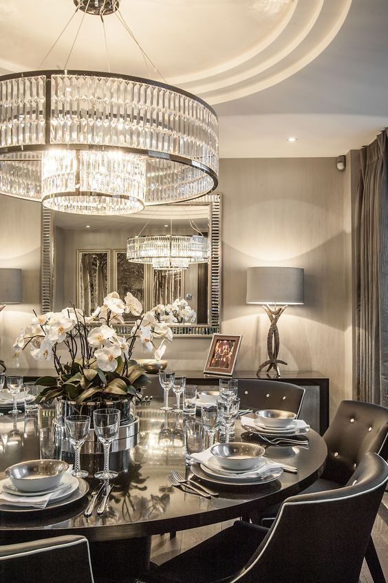 oversized round crystal chandelier with two layers looks modern and edgy