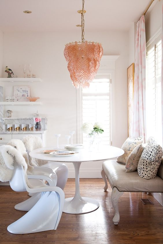 unique pink glass chandelier over the dining area