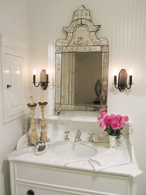 vintage mirror with a mirrored frame for a refined touch