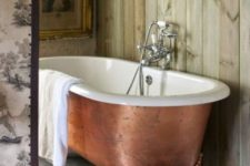 32 a copper leaf bathtub on clawfoot legs makes a refined statement