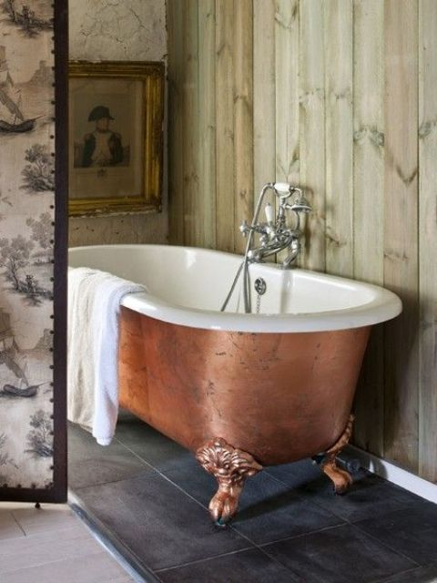 a copper leaf bathtub on clawfoot legs makes a refined statement