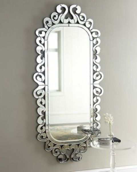 pretty feminine mirror with curled mirrored frame