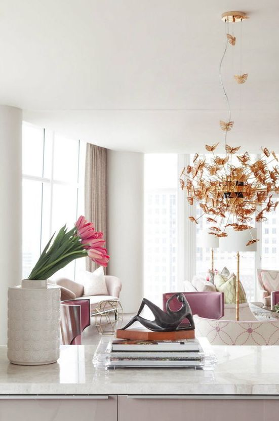 sculptural gold butterfly wedding chandelier makes a statement