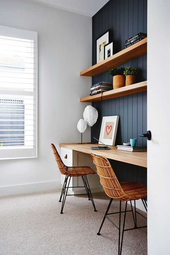 thick floating shelves and a desk with the same top in a niche