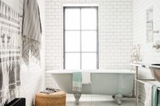 34 a mint bathtub in the shower area of a retro-inspired bathroom