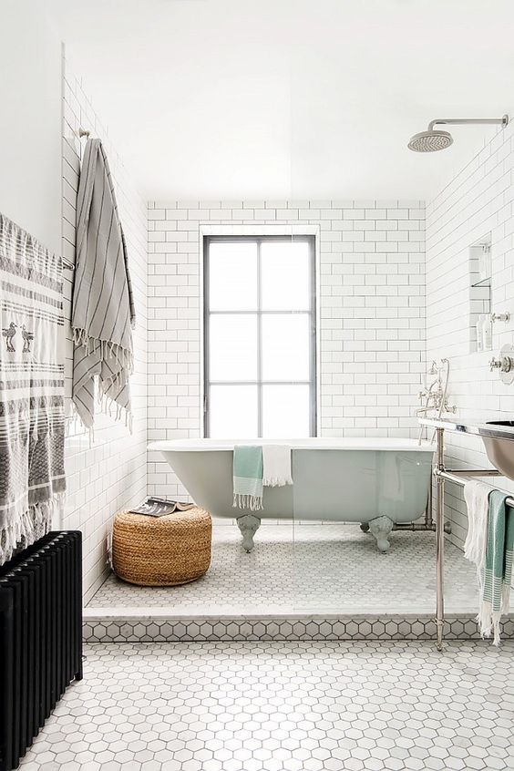 a mint bathtub in the shower area of a retro-inspired bathroom