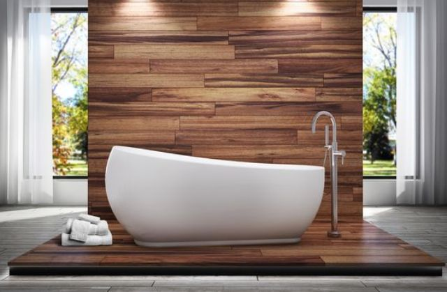 a wood tile wall and floor and an egg-shaped tub with a gentle slope