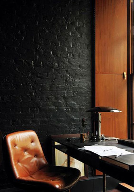 traditional black table lamp for a black and cognac-colored office