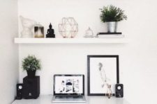 34 white floating shelves echo with the white lacquer desk for a perfect stylish look