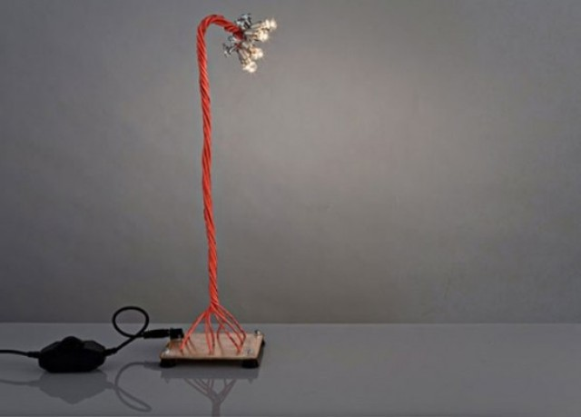 industrial table lamp with bold red cords and small bulbs