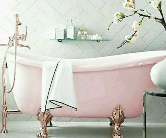 A Pink Slip Freestanding Bathtub With Rose Gold Legs And Bathtub Filler For  A Feminine Space