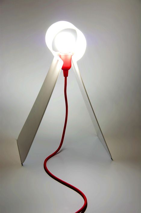 metal lamp of a single sheet and a bulb with a red cord