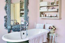 37 a shabby chic bathroom with a green bathtub on dark metal legs