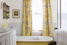 38 a sunny yellow bathtub and floral curtains for a shiny bathroom