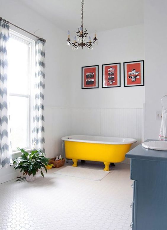 Modern Bathroom With Blue Touches And A Sunny Yellow Bathtub With Legs
