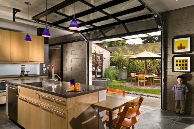 open your kitchen to the courtyard with a garage door to enjoy your meals outside