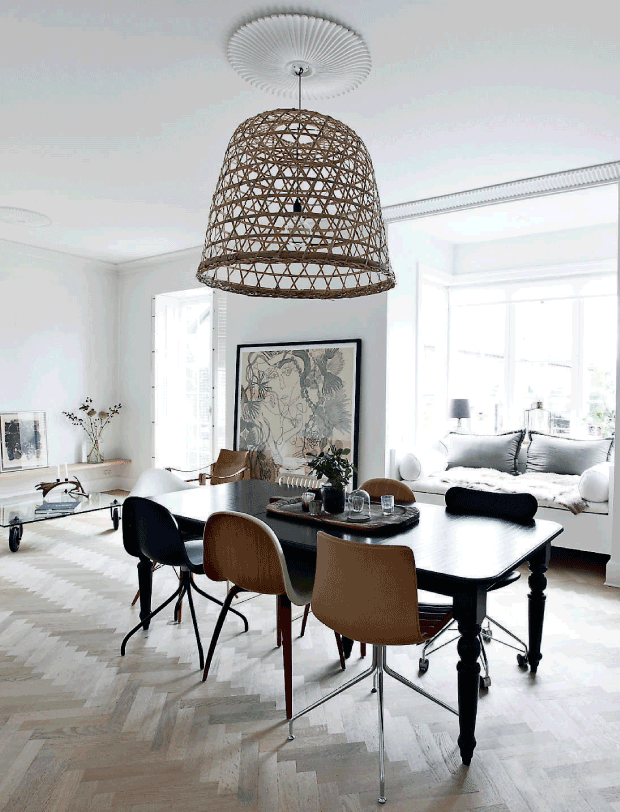 The living and dining space have an open layout, they are flooded with light, like it should be with Nordic interiors