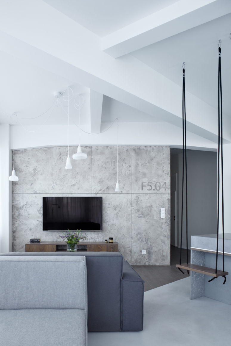 High ceilings were highlighted with pendant lamps, and concrete panels reminded of industrial nature of the building