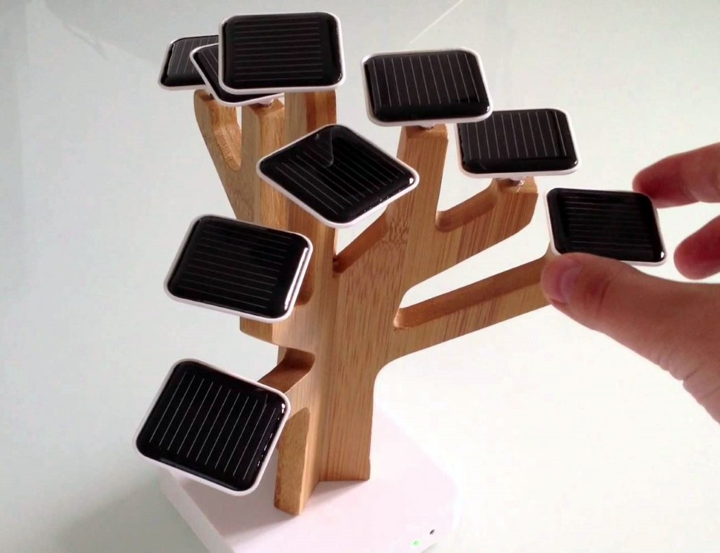 It reminds of a bonsai tree but a modern, fresh and hig tech take on it