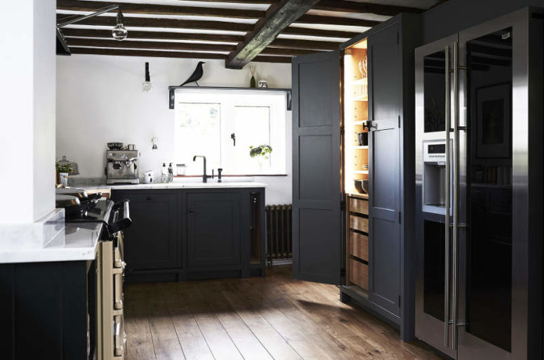 The cabinets are graphite grey with a white marble top, there's a built-in pantry for more storage