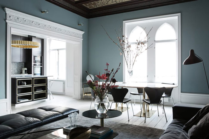 The grey blue walls are combines with whitewashed floors and vaulted ceilings for a unique look and an airy feel