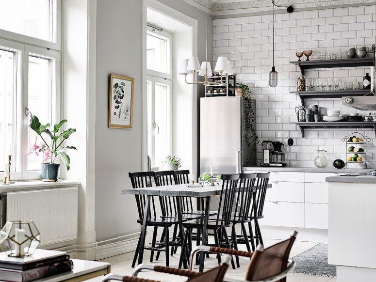 The kitchen is united with the dining and living spaces to create one open layout