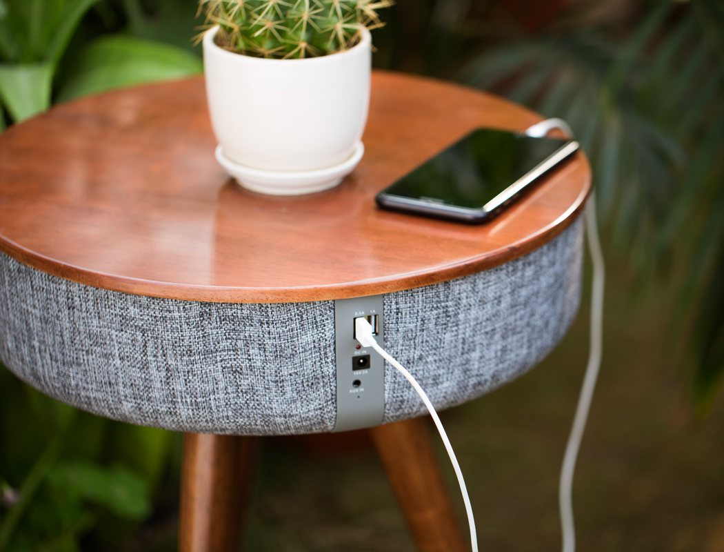 There are USB ports for your phones that allow charging