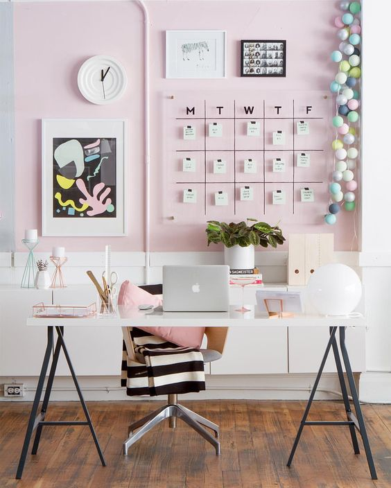 a feminine home office can be psruced up with a blush statement wall