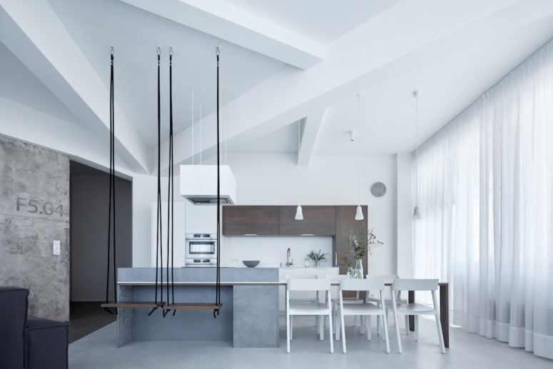 A sculptural ceiling looks stunning, and swing seats for the breakfast zone are a cool idea, I also love a concrete kitchen island