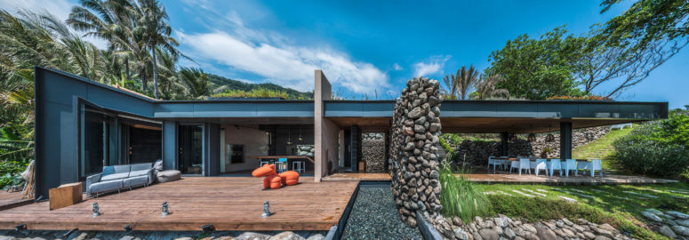 The extensive use of wood and large stones add a textural look to the outdoor space