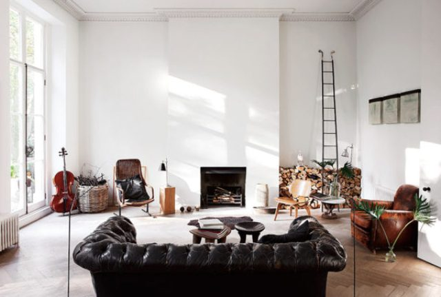 The living space features white walls and wooden floors and modern furniture of leather and rattan - the owner decided to emphasize the interiors with textures
