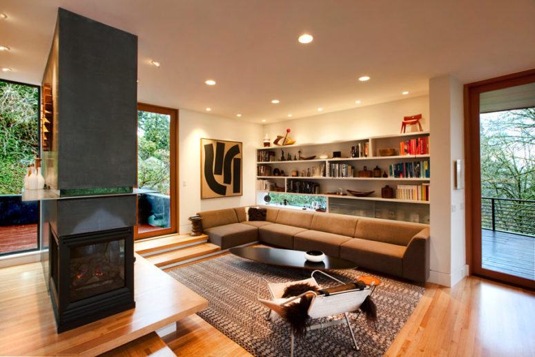 This is a cozy living space with a fireplace and a door to the terrace