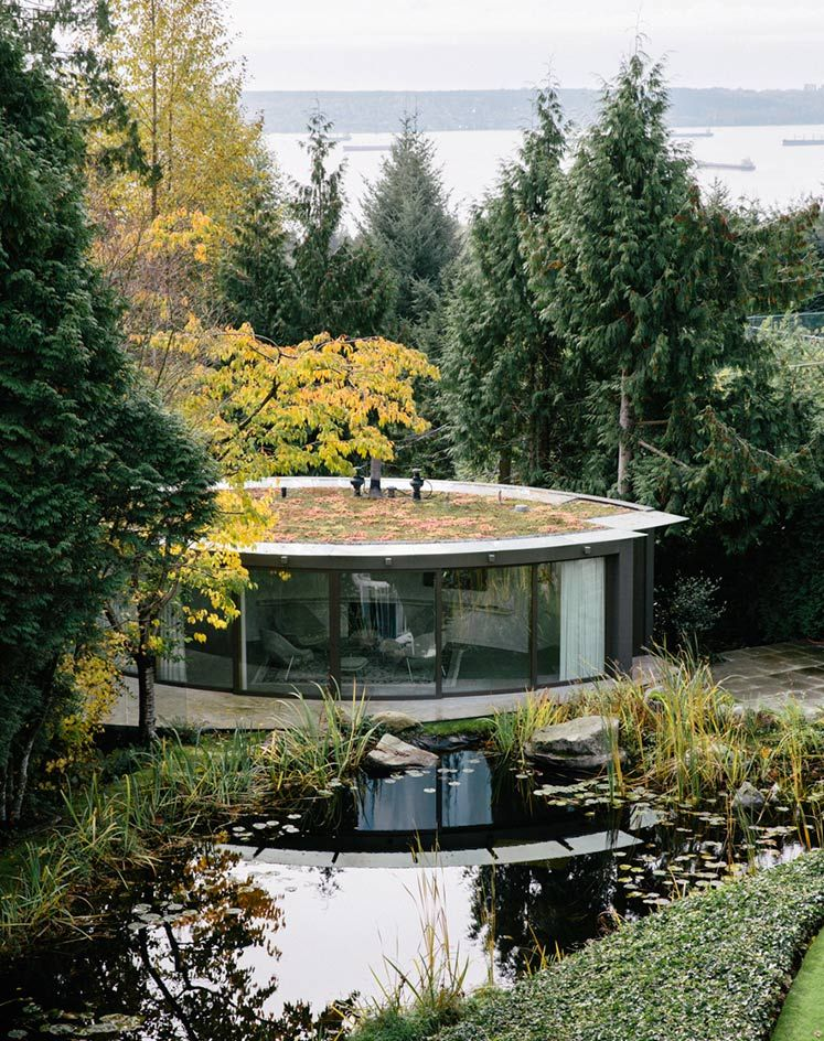 There's a guest house for the south end of the garden, with views up to the main house and its reflection in a pond