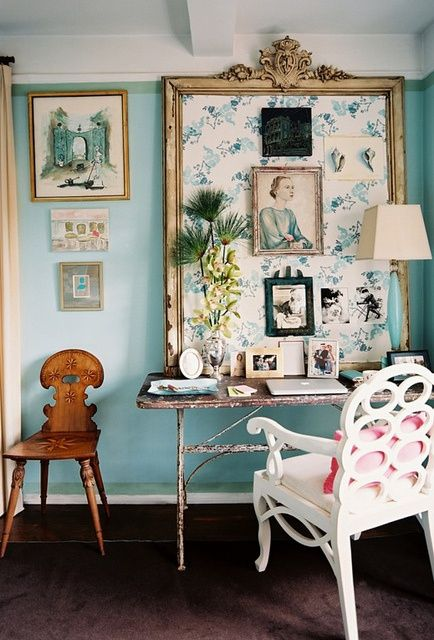 a light blue statement wall and works of art are amazing for a girlish space