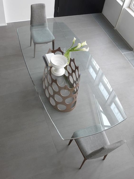 glass top dining table with metallic base and retro elegance